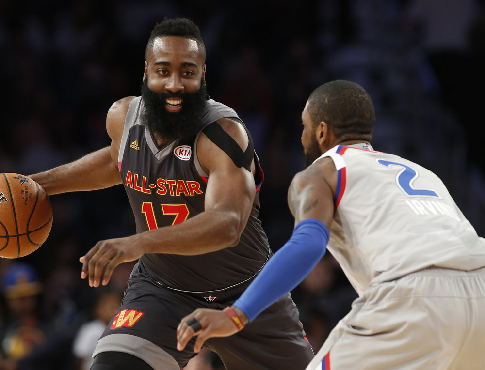 Western Conference guard James Harden of the Houston Rockets, left, smiles as he dribbles around Eastern Conference guard Kyrie Irving of the Cleveland Cavaliers (2) during the second half of the NBA All-Star basketball game in New Orleans, Sunday, Feb. 19, 2017. (Max Becherer/AP)
