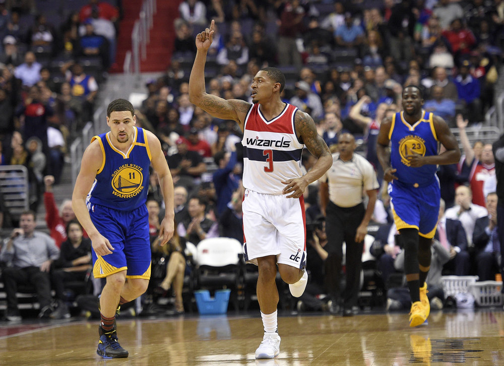 Washington Wizards guard Bradley Beal (3) gestures during the first half of an NBA basketball game next to Golden State Warriors guard Klay Thompson (11) and forward Draymond Green (23), Tuesday, Feb. 28, 2017, in Washington. (Nick Wass/AP)