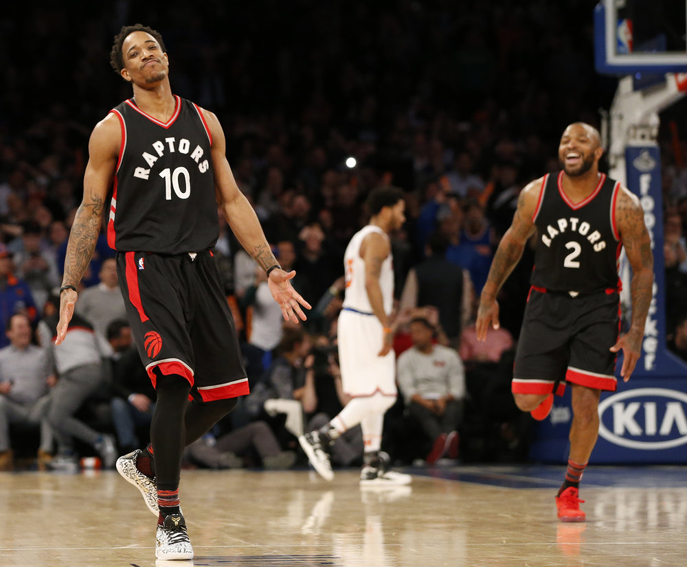 Toronto Raptors guard DeMar DeRozan (10) and forward P.J. Tucker (2) celebrate after DeRozan hit a turnaround jumper in the waning seconds of the fourth quarter of an NBA basketball game against the New York Knicks at Madison Square Garden in New York, Monday, Feb. 27, 2017.  (Kathy Willens/AP)