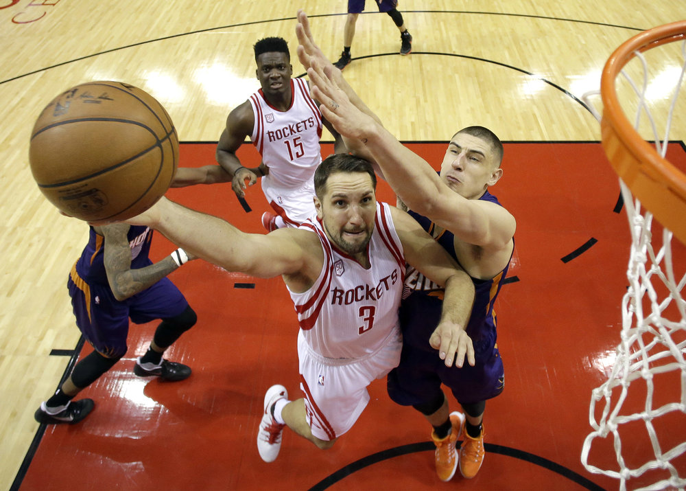 Houston Rockets' Ryan Anderson (3) goes up for a shot as Phoenix Suns' Alex Len defends during the second half of an NBA basketball game, Saturday, Feb. 11, 2017, in Houston. (David J. Phillip/AP)