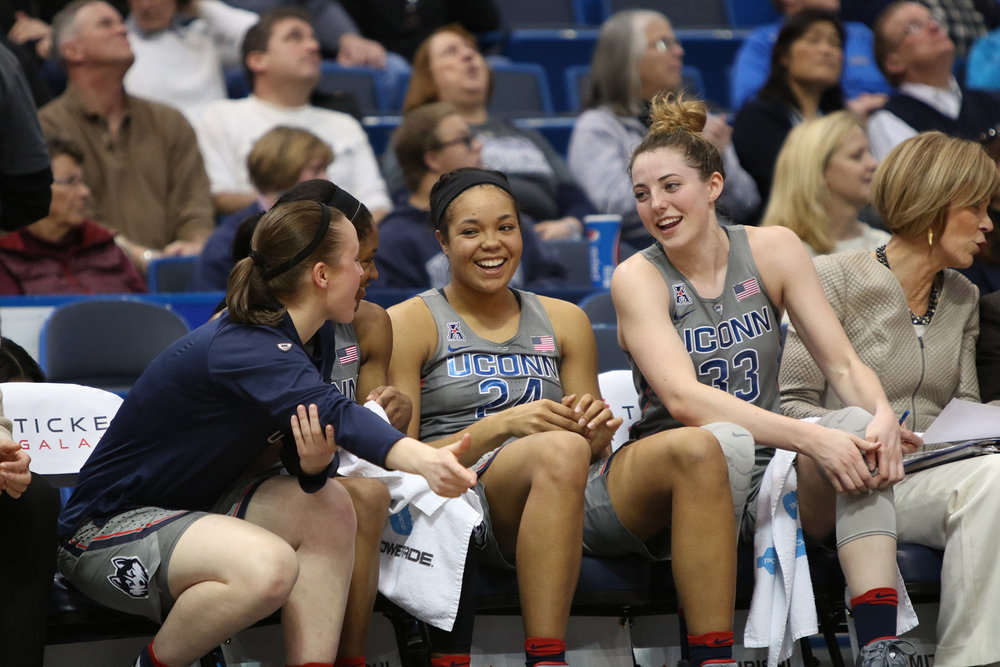 Katie Lou Samuelson and Napheesa Collier laugh on the bench with teammates as UConn women's basketball team defeats Temple 90-45 on Wed., Feb. 22, 2017 at the XL Center in Hartford. (Jackson Haigis/ The Daily Campus)