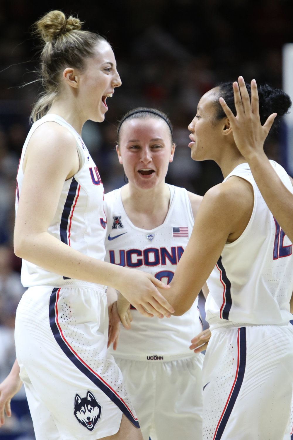 Katie Lou Samuelson and Saniya Chong celebrate during the Huskies 91-48 victory over Memphis on Feb. 27, 2017. (Jackson Haigis/The Daily Campus)