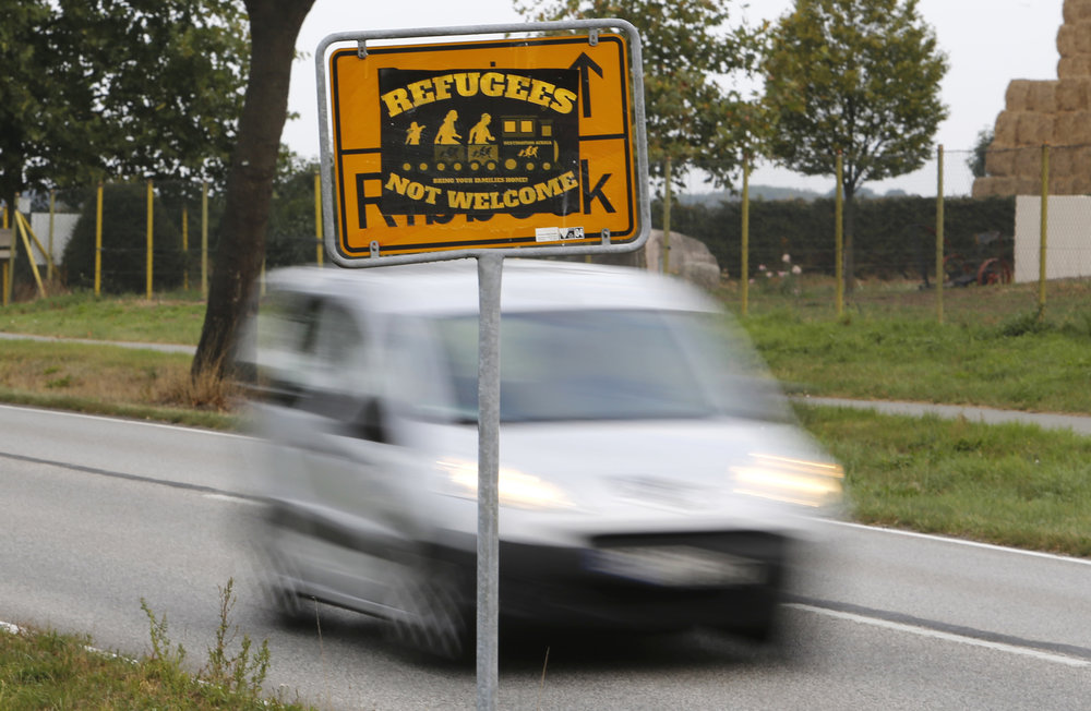 The Sept. 23, 2016 shows a poster 'Refugees not welcome' sticked on a city sign in the outskirts of Nauen, eastern Germany, one of several thousand hate crimes in Germany in 2016. (Ferdinand Ostrop/AP)