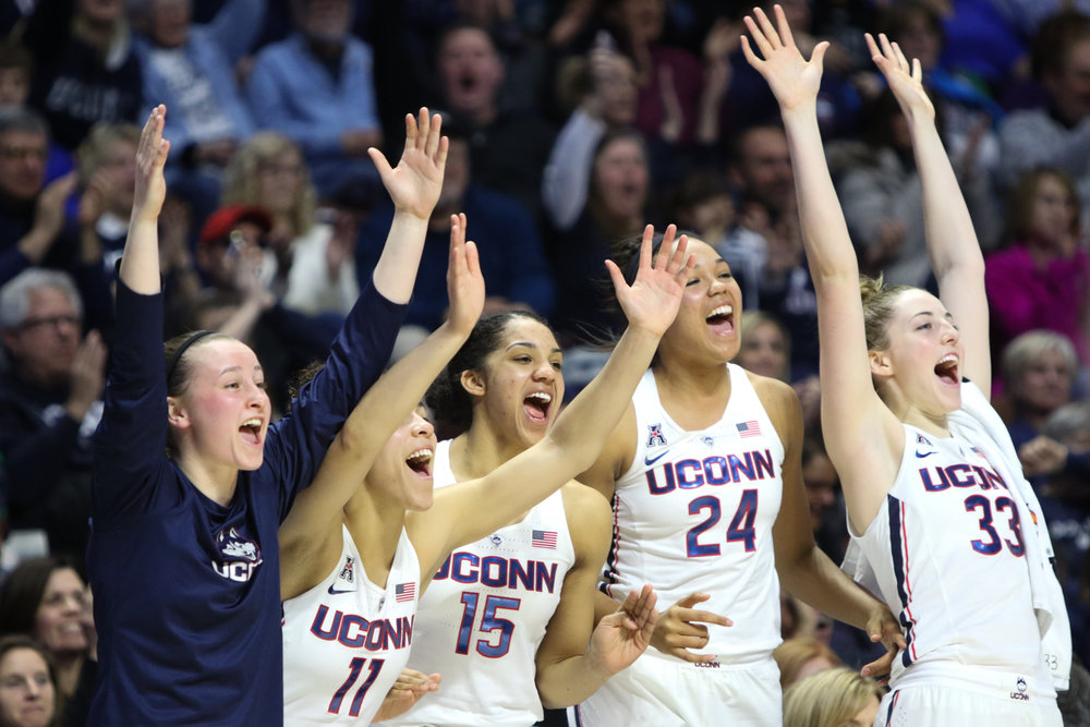 The UConn bench celebrates teammate Molly Bent's second-half three pointer during the Huskies' 105-57 win over Tulsa in the American Athletic Conference tournament quarterfinals at Mohegan Sun Arena in Uncasville on Saturday afternoon. Napheesa Collier (24) led the Huskies with 24 points. (Jackson Haigis/The Daily Campus)