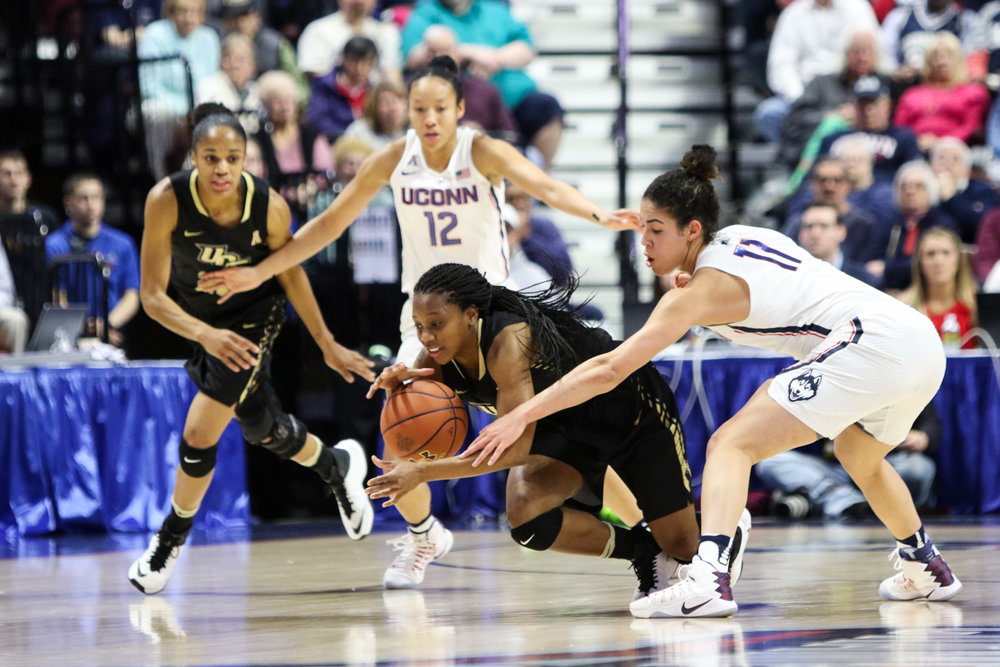 UConn guard Kia Nurse and UCF guard Zykira Lewis fight for the ball during UConn's 78-56 win over the Golden Knights in the AAC semifinals on Sunday afternoon at Mohegan Sun Arena. Lewis had 22 points for the Golden Knights and Nurse scored 9 for the Huskies. (Jackson Haigis/The Daily Campus)