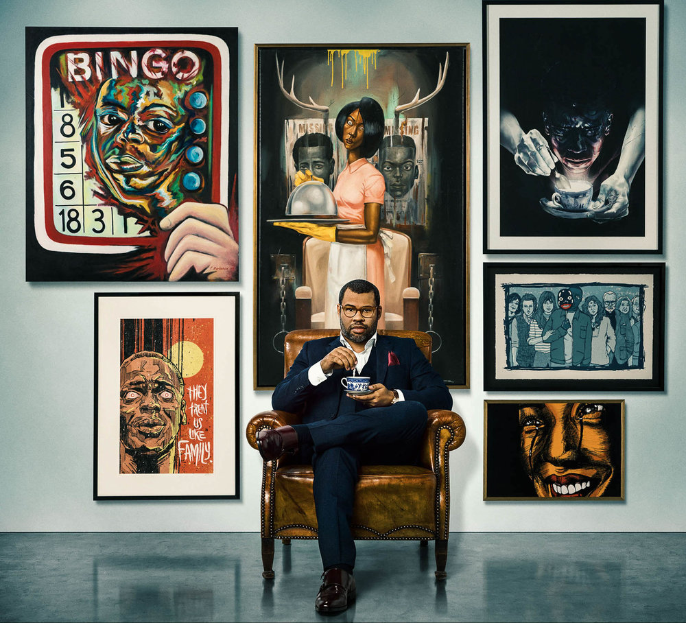 "Director Jordan Peele poses with artwork based off his new hit film ""Get Out."" (Image via  getoutfilm.com )"