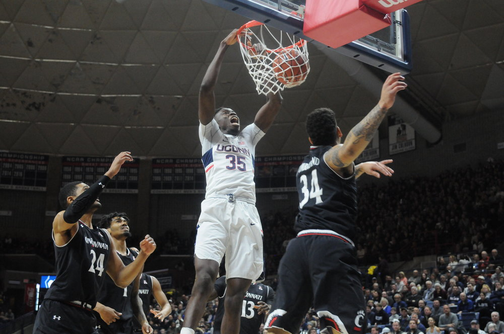 Senior Amida Brimah dunks during UConn's loss to Cincinnati on Sunday March 5th. It was Brimah's last game at Gampel Pavilion. (Amar Batra/The Daily Campus)