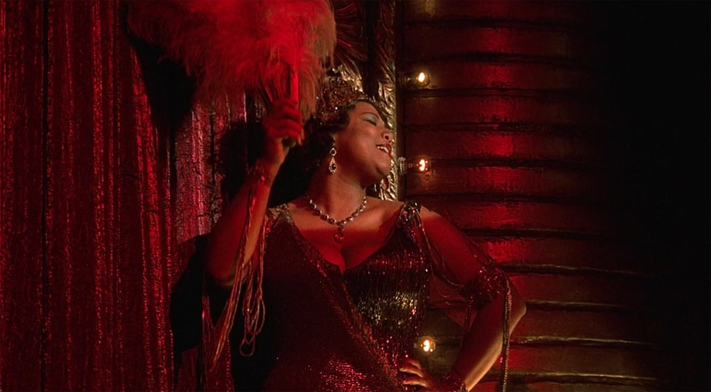 "Queen Latifa in musical comedy ""Chicago"".  The movie won an Academy Award for Best Picture in 2003.  The movie is now available on Netflix.  (screenshot/Nwtflix)"