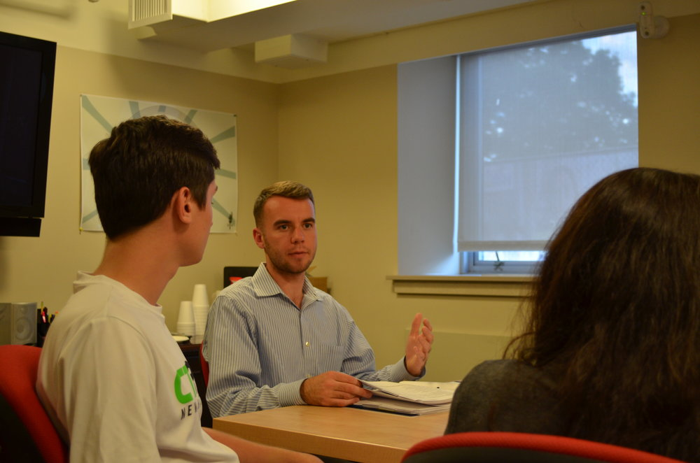 Senior political science major Adam Kuegler, who is an undergraduate student representative on the Board of Trustees, meets with other UConn students from the regional campuses. (Akshara Thejaswi/The Daily Campus)
