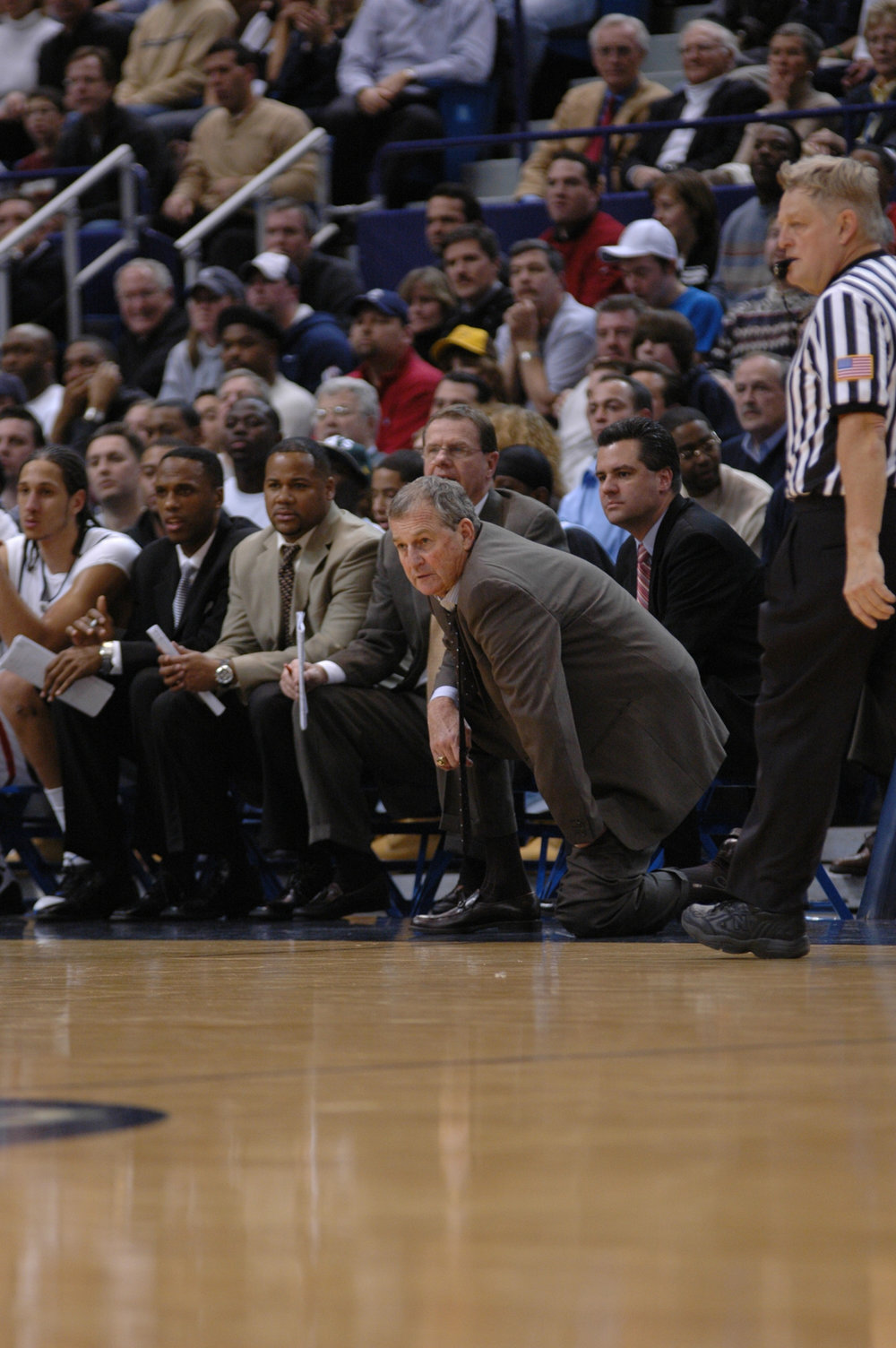 Tom Moore, pictured to the right of Jim Calhoun, has been fired as the coach of the Quinnipiac Bobcats as of Tuesday. (File Photo/The Daily Campus)