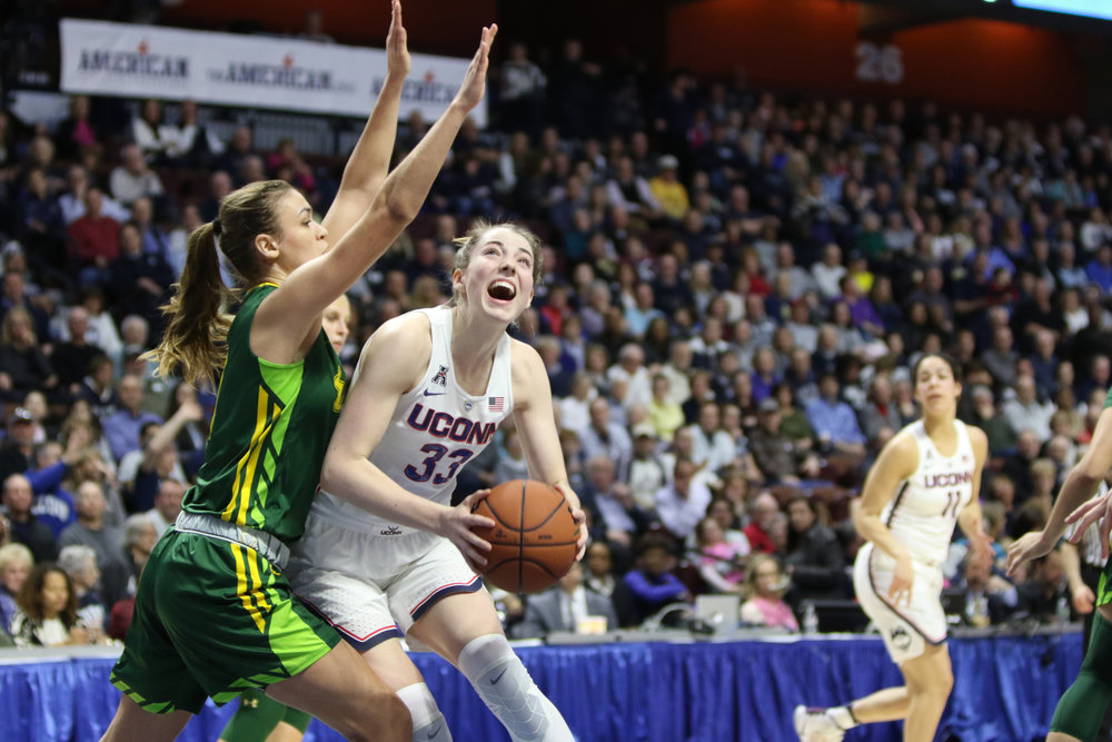 Katie Lou Samuelson starts a layup during the Huskies 100-44 victory over USF to win the American Conference Championships on Monday, March 6, 2017. (Jackson Haigis/The Daily Campus)