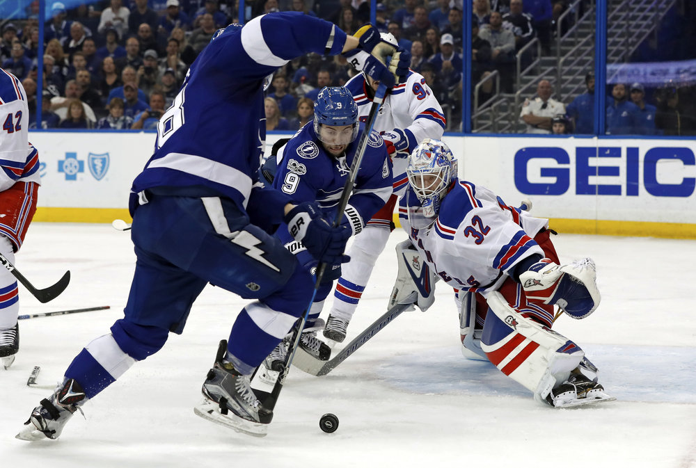 New York Rangers goalie Antti Raanta, of Finland, looks for a rebound as Tampa Bay Lightning's Tyler Johnson reaches for it during the second period of an NHL hockey game, Monday, March 6, 2017, in Tampa, Fla. (Mike Carlson/AP)