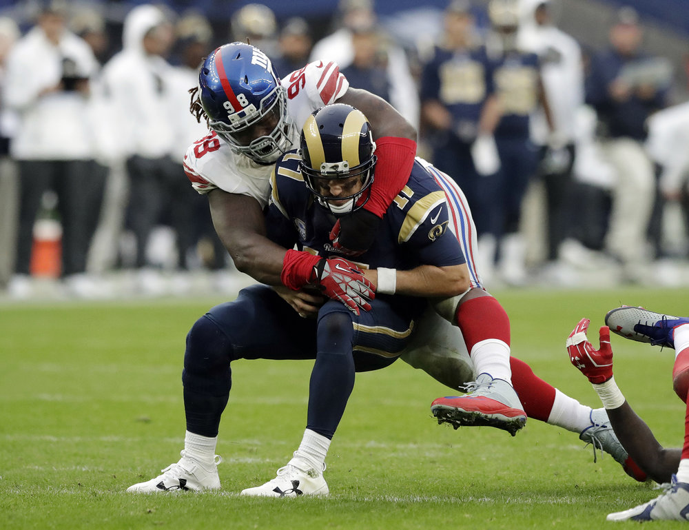 "In this Oct. 23, 2016, photo, New York Giants defensive tackle Damon Harrison (98) tackles Los Angeles Rams quarterback Case Keenum (17) during an NFL football game at Twickenham stadium in London. Defensive tackle Damon ""Snacks"" Harrison played right under the noses of the New York Giants, spending his first four seasons in the same stadium playing for the Jets after going undrafted out of the NAIA-level William Penn. (Matt Dunham/AP)"