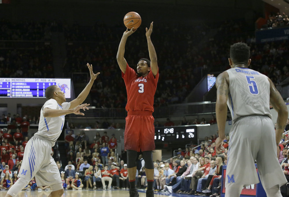 SMU guard Sterling Brown (3) shoots against against Memphis defenders Dedric Lawson (1) and Markel Crawford (5) during the second half of an NCAA college basketball Saturday, March 4, 2017, in Dallas. SMU won 103-62. (LM Otero/AP)
