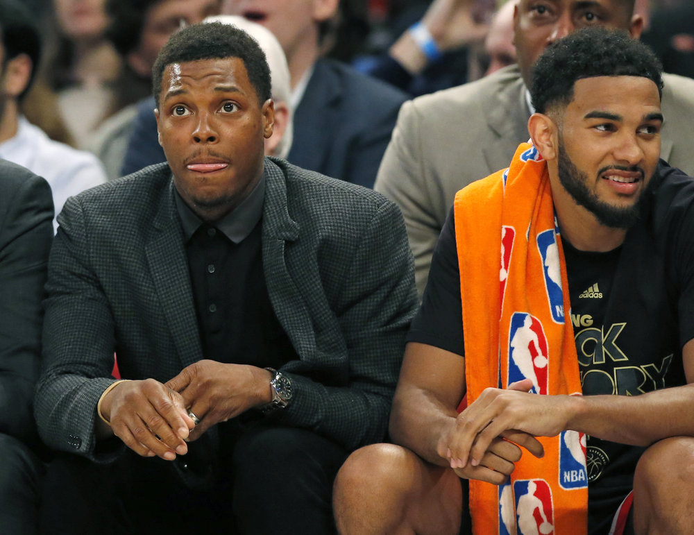 Toronto Raptors Kyle Lowry, who is out with a right wrist injury, sits beside Raptors guard Cory Joseph on the bench during the first half of an NBA basketball game against the New York Knicks at Madison Square Garden in New York, Monday, Feb. 27, 2017. Lowry is scheduled to have surgery on his wrist Tuesday. (Kathy Willens/AP)