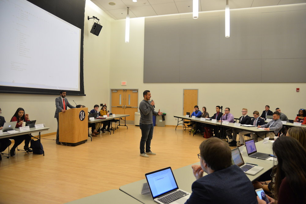 The Undergraduate student government meets in the SU ballroom for its weekly meeting on March 8, 2017. Items discussed included a motion to ask the Foundation to not invest in fossil fuels and a motion to add a temporary justice to fill in for Chief Justice Andrew Stern during hearings on the presidential race. (Amar Batra/The Daily Campus)