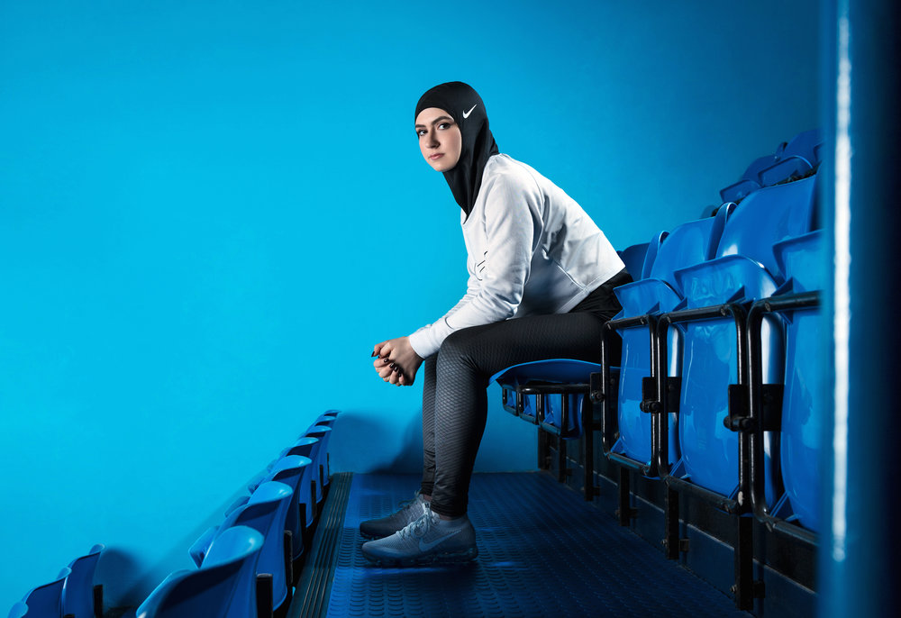 In this undated image provided by Nike, figure skater Zahra Lari model wears Nike's new hijab for Muslim female athletes. The pull-on hijab is made of light, stretchy fabric that includes tiny holes for breathability and an elongated back so it will not come untucked. (Nike/AP Exchange)
