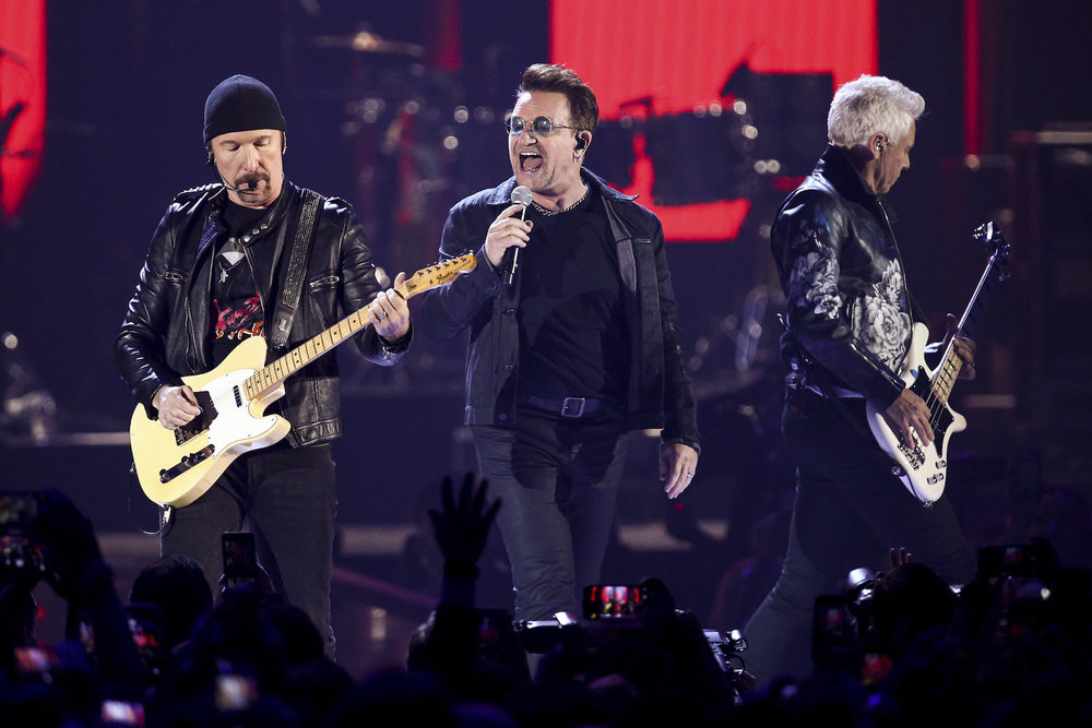 In this Sept. 23, 2016, file photo, The Edge, from left, Bono and Adam Clayton of the music group U2 perform at the 2016 iHeartRadio Music Festival - Day 1 in Las Vegas. (John Salangsang/AP Exchange)
