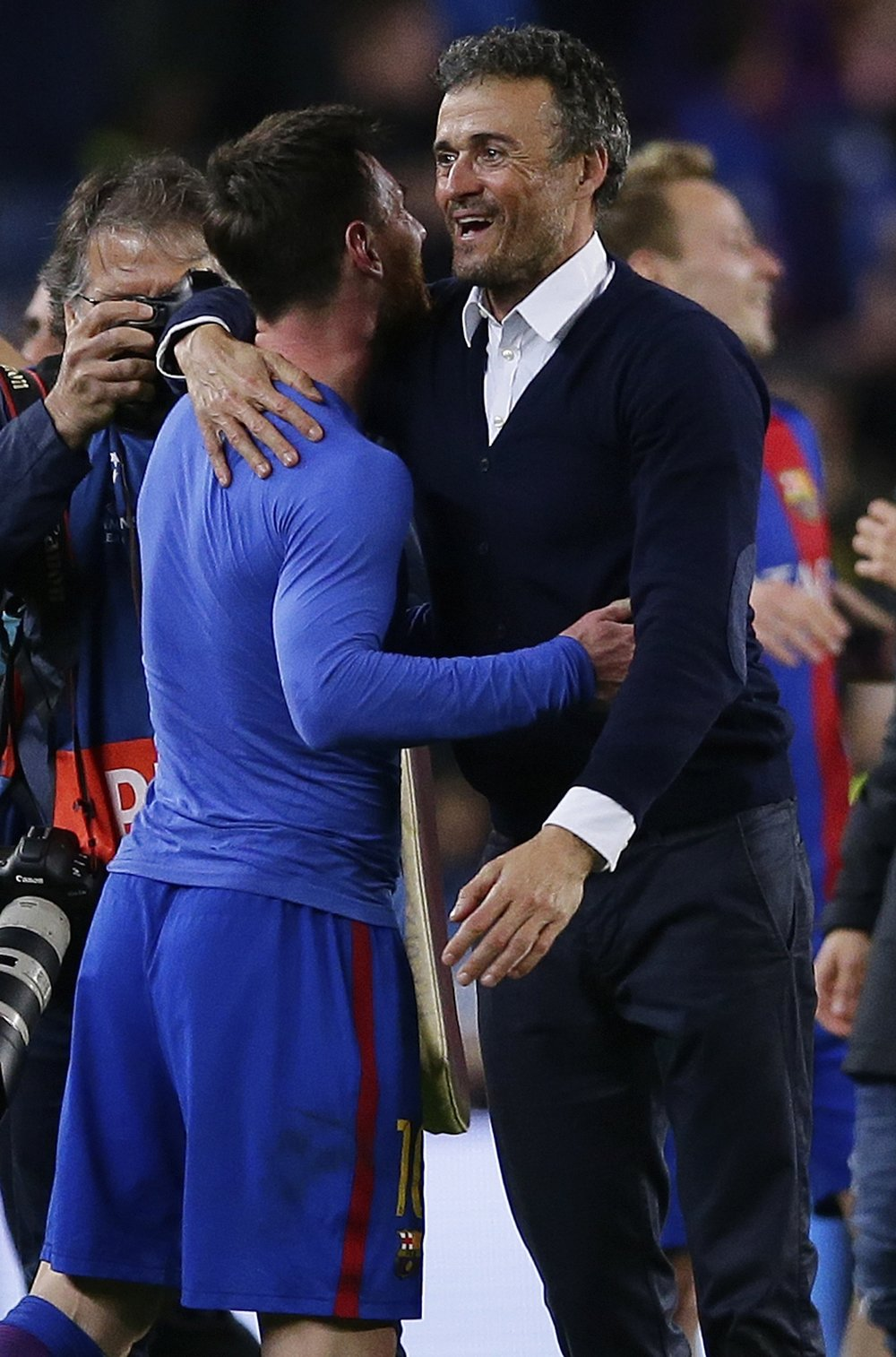 Barcelona's head coach Luis Enrique celebrates with Lionel Messi at the end of the Champions League round of 16. (Manu Fernandez/AP)
