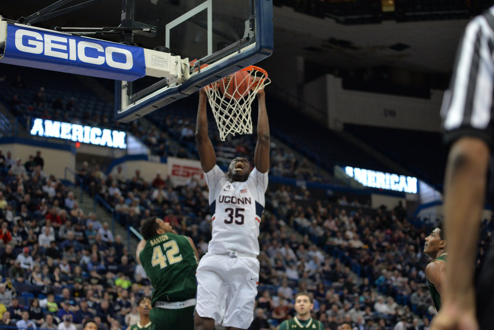 Amida Brimah blows past the USF defense to slam home a dunk during UConn's 77-66 win over the Bulls on Thursday, March 9, 2017 at the XL Center in Hartford. The Huskies will take on Houston tonight at 9 p.m. in the second round of the conference tournament. (Amar Batra/The Daily Campus)