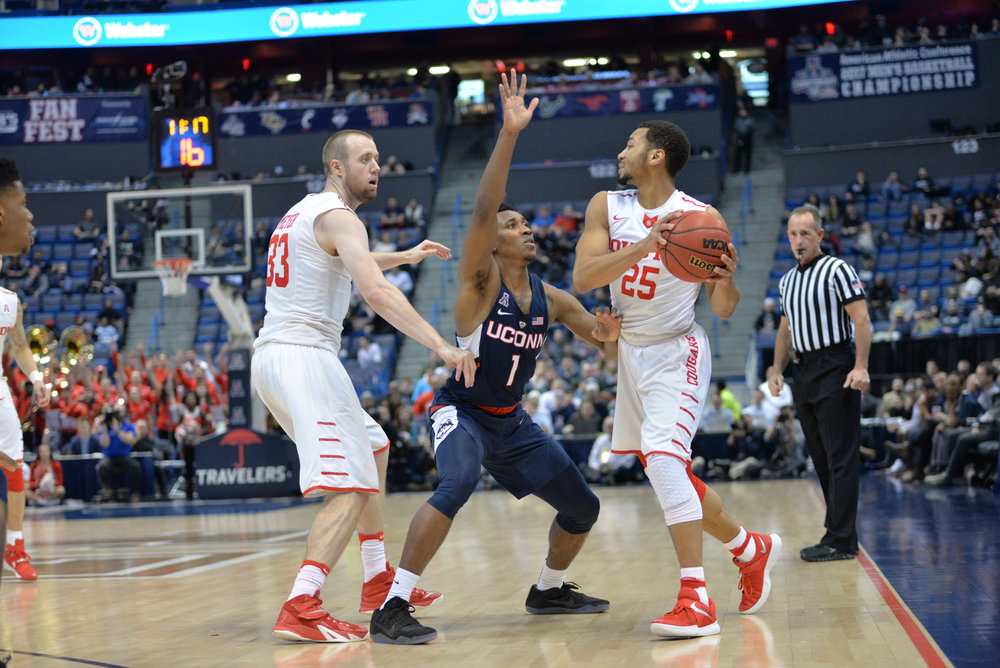 Christian Vital defends Houston's Galen Robinson (25) in UConn's 74-65 win over the Cougars in the quarterfinals of the American Athletic Conference Tournament on Friday, March 10, 2017 at the XL Center in Hartford. Vital scored 12 points and played emphatic defense to help push the Huskies to the semifinals. (Amar Batra/The Daily Campus)