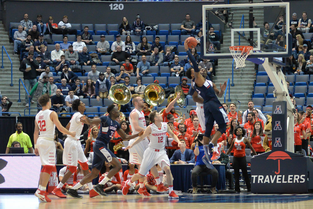 Vance Jackson flies past the Houston defense to slam home a monstrous dunk in UConn's 74-65 win over the Cougars on Friday, March 10 at the XL Center in Hartford in the second round of the AAC tournament. (Amar Batra/The Daily Campus)