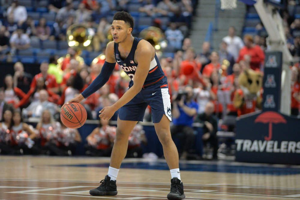 Jalen Adams dribbles the ball at half court during UConn's 74-65 win over Houston in the American Athletic Conference Tournament quarterfinals on Friday, March 10 at the XL Center in Hartford. Adams scored a team-best 23 points. (Amar Batra/The Daily Campus)