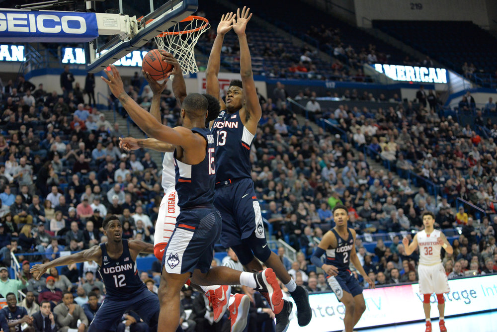 Steven Enoch (13) and Rodney Purvis (15) attempt to block a Houston player in UConn's 74-65 win over Houston in the second round of the American Athletic Conference tournament on Friday, March 10, 2017 at the XL Center in Hartford. (Amar Batra/The Daily Campus)