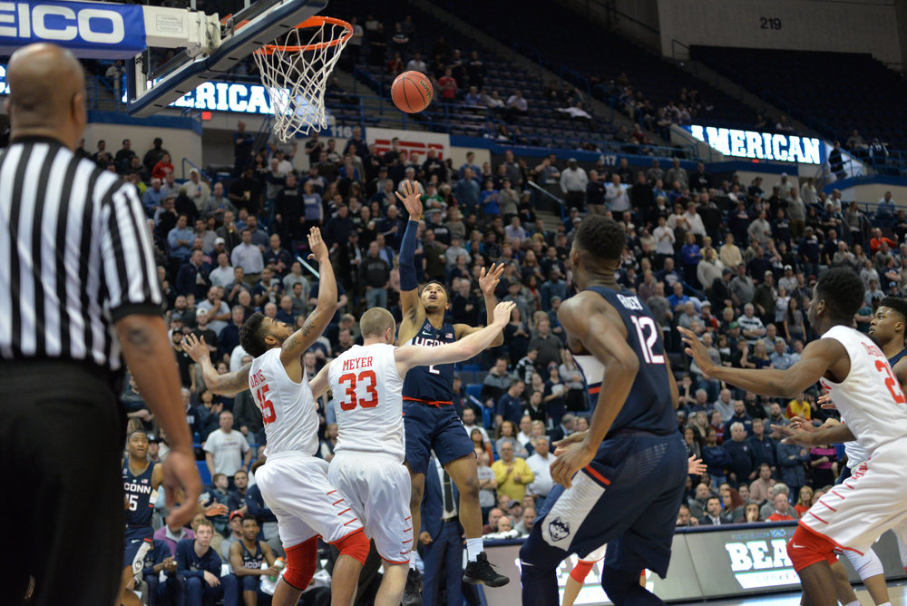 Jalen Adams takes a long-range jumper over two Houston defenders in UConn's 74-65 win over Houston in the second round of the American Athletic Conference tournament on Friday, March 10, 2017 at the XL Center in Hartford. (Amar Batra/The Daily Campus)