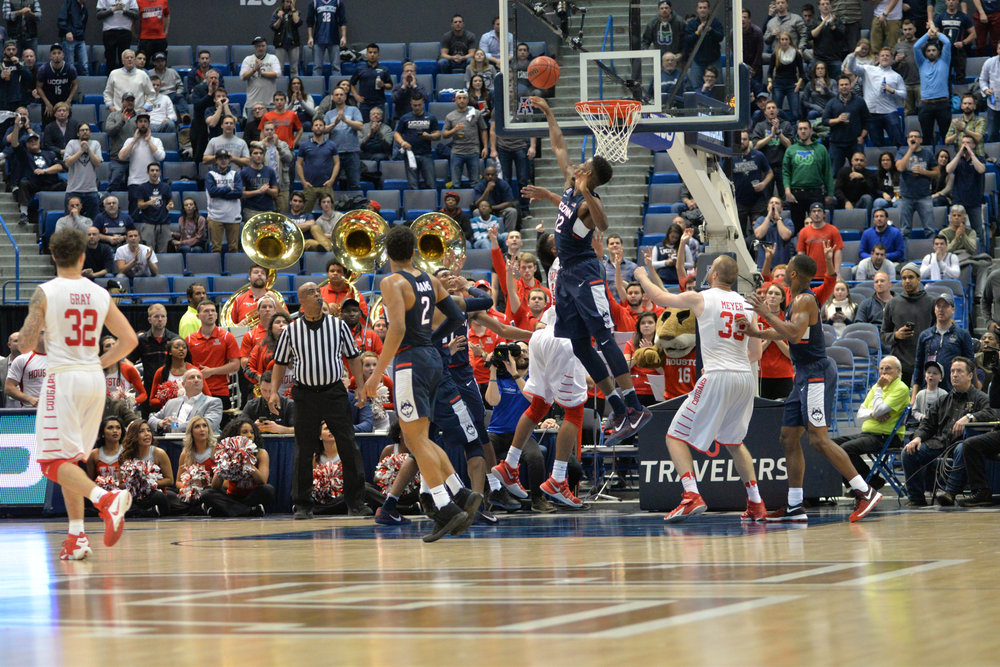 Kentan Facey swats away the ball under the Houston basket in UConn's 74-65 win over Houston in the second round of the American Athletic Conference tournament on Friday, March 10, 2017 at the XL Center in Hartford. (Amar Batra/The Daily Campus)