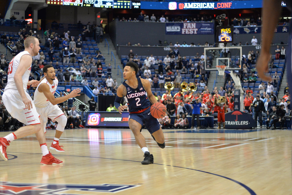 Jalen Adams begins to move the ball past Houston defenders in UConn's 74-65 win over Houston on Friday, March 10 at the XL Center in Hartford. Adams and the Huskies will battle rival Cincinnati in the semifinals today. (Amar Batra/The Daily Campus)