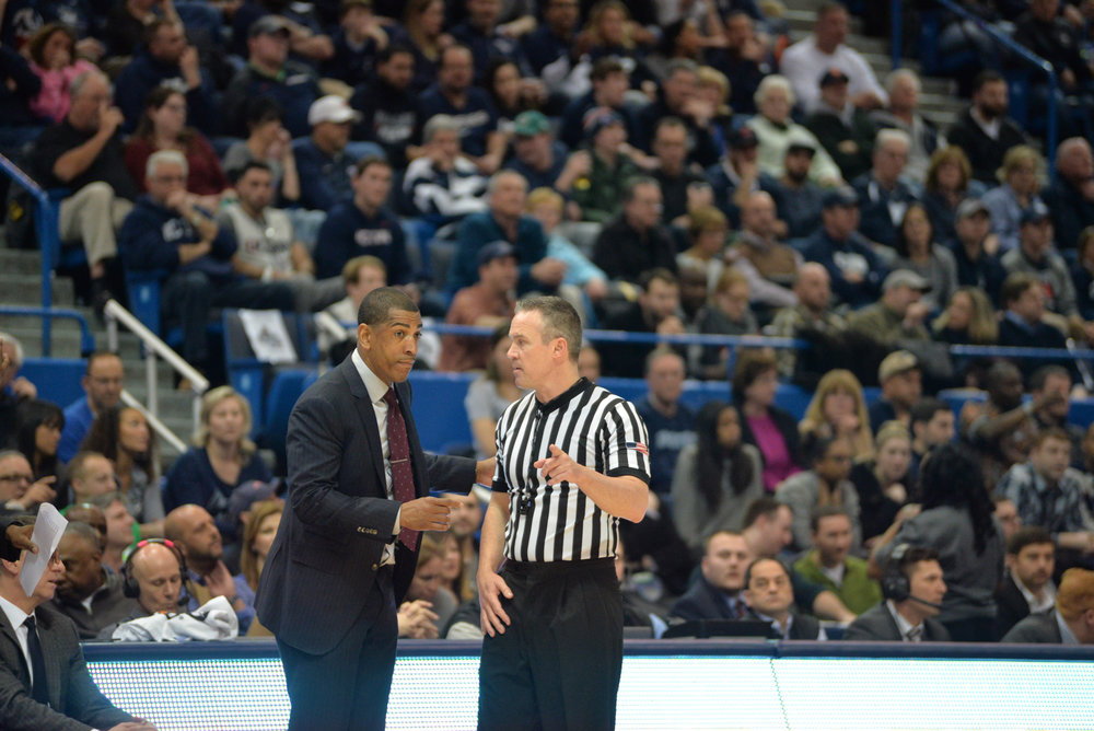 UConn head coach Kevin Ollie talks with an official in UConn's 81-71 loss to Cincinnati in the American Athletic Conference semifinals on March 11, 2017. (Amar Batra/The Daily Campus)
