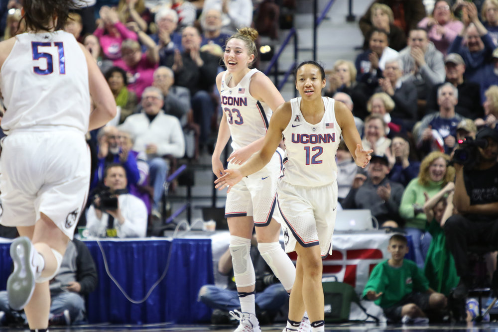 Katie Lou Samuelson (33) and Saniya Chong (12) celebrate in UConn's 100-44 win over USF in the American Athletic Conference tournament championship on March 6, 2017. (Jackson Haigis/The Daily Campus)
