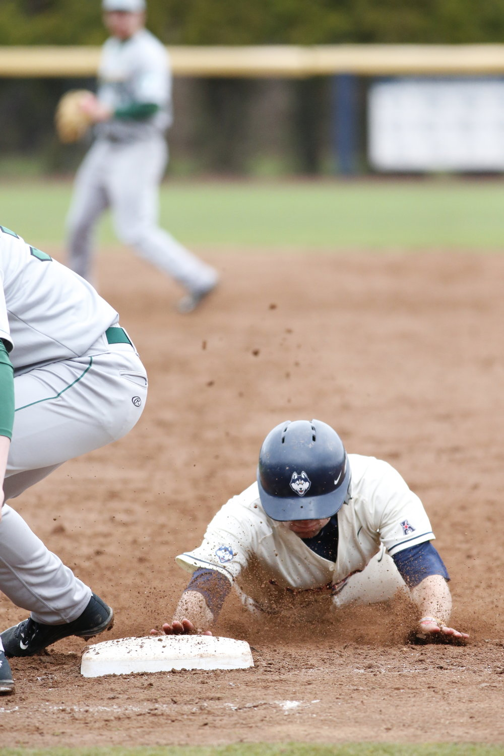 A UConn baseball player slides back into first base during a game against Tulane last season. (Tyler Benton/The Daily Campus)