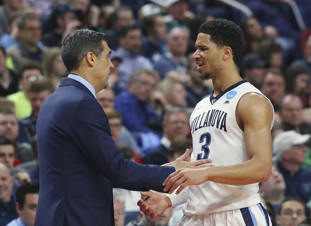 Villanova coach Jay Wright and guard Josh Hart talk during the second half of a second-round game against Wisconsin in the NCAA men's college basketball tournament, Saturday, March 18, 2017, in Buffalo, N.Y. Wisconsin won 65-62. (AP Photo/Bill Wippert)