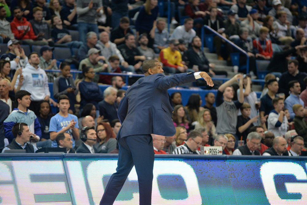 UConn men's basketball head coach Kevin Ollie directs a player during a 74-65 win over Houston on Mar. 10 at the XL Center in Hartford. (Amar Batra/The Daily Campus)