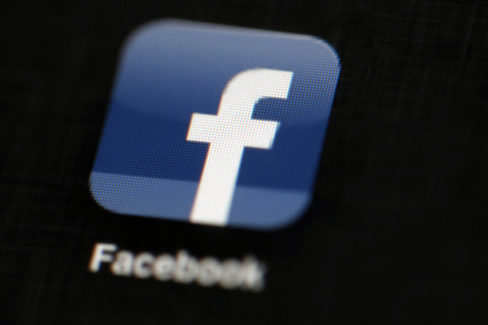 In this May 16, 2012, file photo, the Facebook logo is displayed on an iPad in Philadelphia.  Recently, the government has attempted to sway social media companies to take down blasphemous content.  (Matt Rourke/AP)