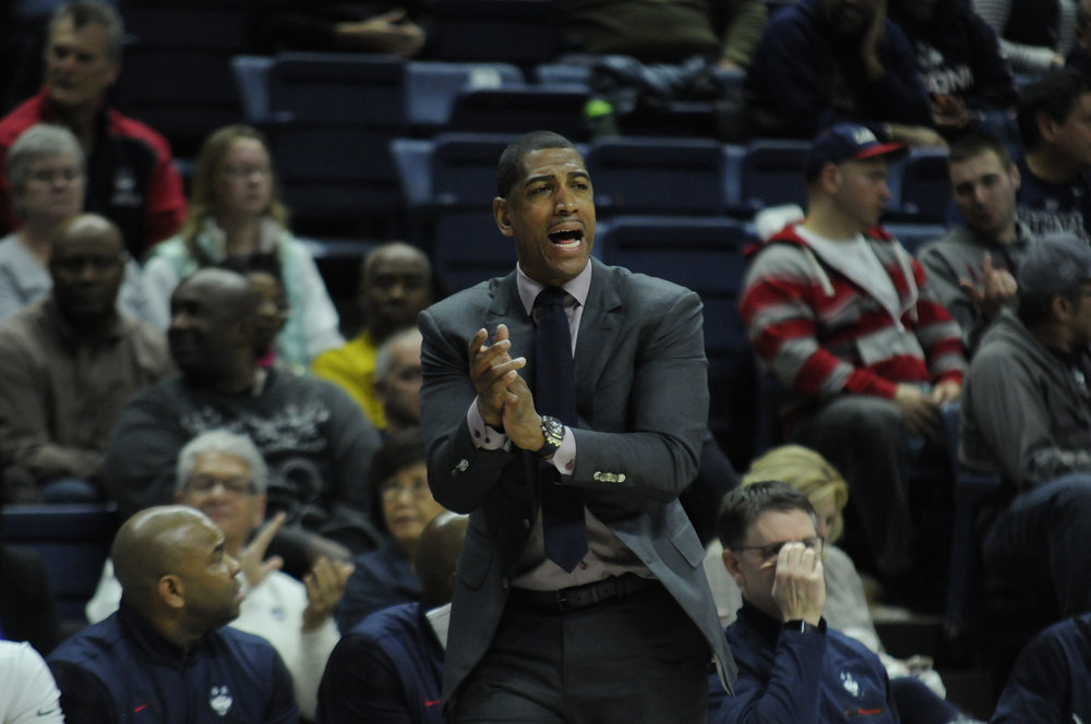 UConn took on Tulane University on Saturday, January 28 at Gampel Pavilion. Though the Huskies were behind throughout the first half of the game, they came back and overtook Tulane in a 78-68 victory. Coach Kevin Ollie cheers on his team after the Huskies score. (Olivia Stenger/ The Daily Campus)
