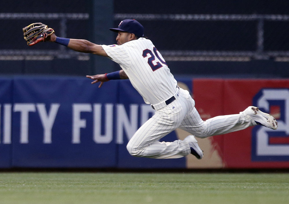 In this July 27, 2016, file photo, Minnesota Twins center fielder Eddie Rosario leaves the turf to catch a fly ball by Atlanta Braves' Ender Inciarte during the third inning of a baseball game, in Minneapolis. The Minnesota Twins have the makings of a solid outfield for years to come. They've all got high-ceiling potential as hitters, but the most immediate benefit is the speed on defense that ought to help a beleaguered pitching staff. (Jim Mone/AP)