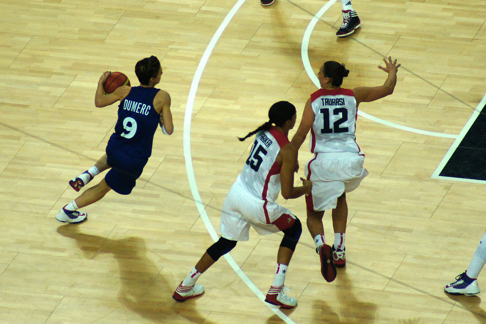Photo from the London 2012 Summer Olympics women's basketball finals.  Diana Taurasi, number 12, was a key player in the NCAA wins for UConn from 2002-2004.  (Daniel Coomber/ Flickr Creative Commons)