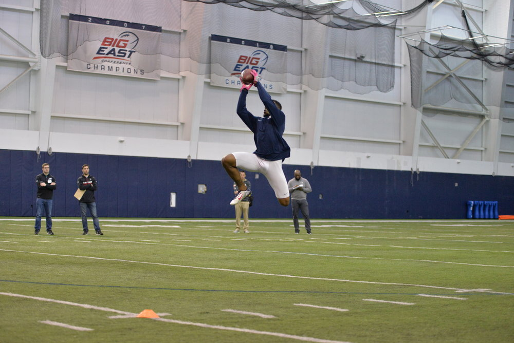 Defensive back John Green completes a pass during the UConn Pro Scouting Day in the Shenkman Training Center on March 22, 2017. (Amar Batra/The Daily Campus)