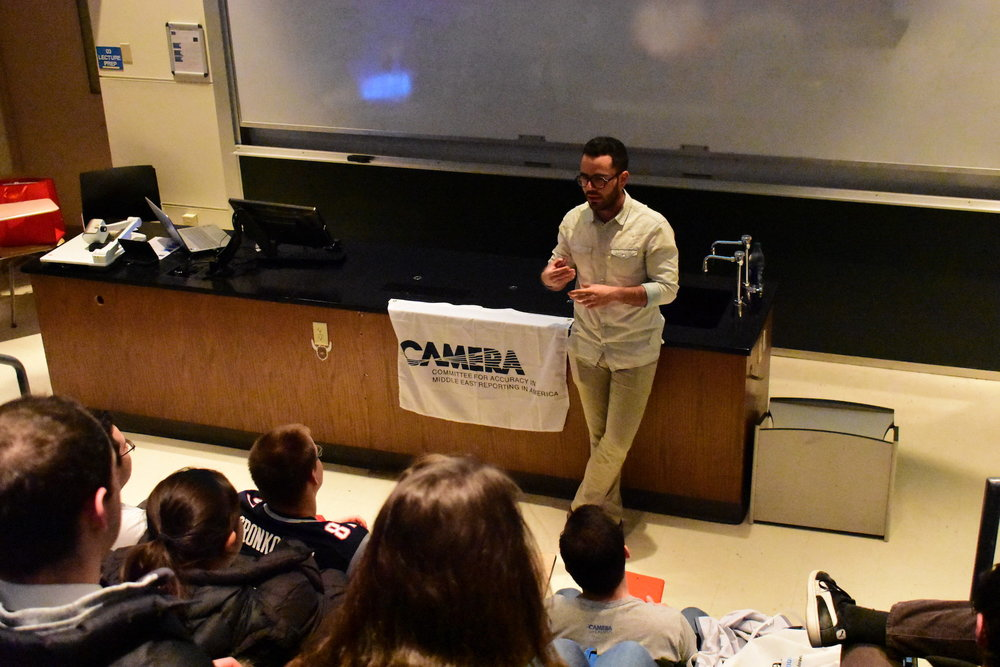"Former Israel Defense Forces commander Hen Mazzig delivered a lecture to students about the struggles of being openly gay in the Middle East. The lecture was followed by a showing of ""Oriented,"" a film by Jake Witzenfeld. (Kevin Musco/The Daily Campus)"