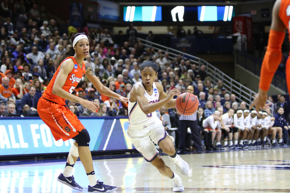 Freshman guard Crystal Dangerfield drives to the basket during the Huskies 94-64 victory over the Syracuse Orange on Monday, March 20, 2017. (Jackson Haigis/The Daily Campus)