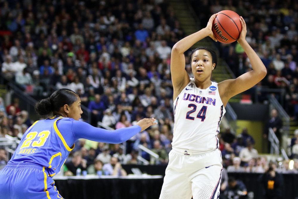 UConn's Napheesa Collier looks to pass in the Huskies' 86-71 win over UCLA on Saturday afternoon at Webster Bank Arena in Bridgeport. Collier scored 27 points to lead the Huskies to an Elite 8 matchup with Oregon on Monday night. (Jackson Haigis/The Daily Campus)