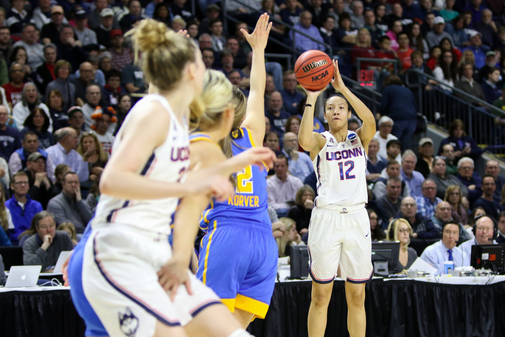 UConn guard Saniya Chong puts up a three-pointer in the Huskies' Saturday afternoon win over UCLA at Webster Bank Arena in Bridgeport. Chong scored 16 points on 4-6 shooting, including 3-5 from beyond the arc. (Jackson Haigis/The Daily Campus)