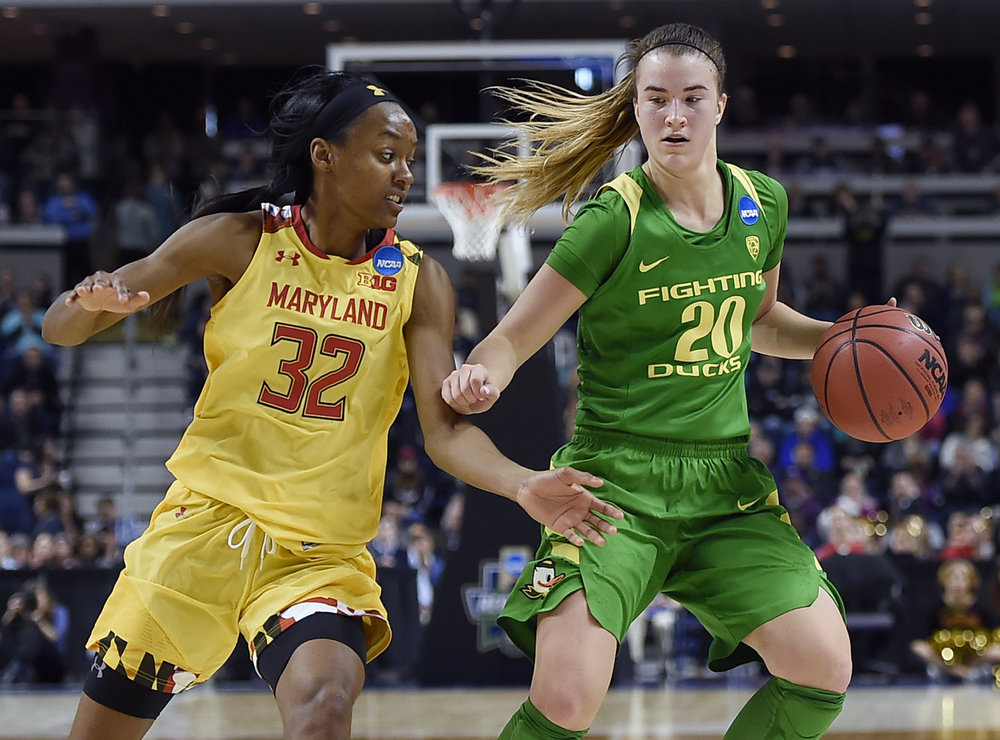 Oregon's Sabrina Ionescu, right, keeps the ball from Maryland's Shatori Walker-Kimbrough, left, during the second half of a regional semifinal game in the NCAA women's college basketball tournament, Saturday, March 25, 2017, in Bridgeport, Conn. (AP Photo/Jessica Hill)