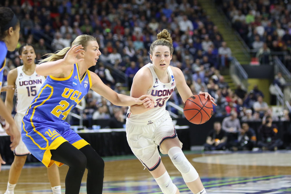 UConn's Katie Lou Samuelson drives to the paint against UCLA's Paulina Hersler during Saturday's win. The UConn women's basketball team advanced to their 12th straight Elite 8 with an 86-71 win over No. 4 UCLA on Saturday afternoon at Webster Bank Arena in Bridgeport. (Jackson Haigis/The Daily Campus)