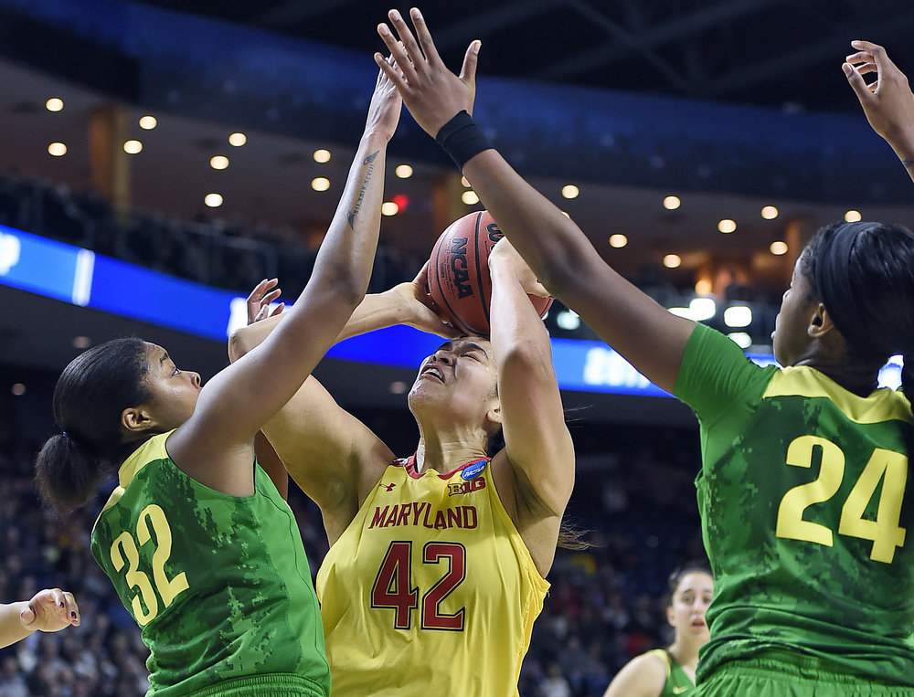 Oregon's Oti Gildon, left, and Ruthy Hebard, right, apply defense against Maryland's Brionna Jones, center, during the second half of a regional semifinal game in the NCAA women's college basketball tournament, Saturday, March 25, 2017, in Bridgeport, Conn. (AP Photo/Jessica Hill)