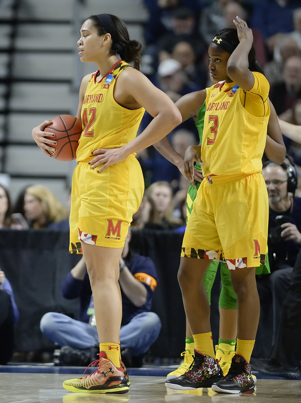Maryland's Brionna Jones, left, reacts to a foul as Kaila Charles looks on during the second half of a regional semifinal game against Oregon in the NCAA women's college basketball tournament, Saturday, March 25, 2017, in Bridgeport, Conn. (AP Photo/Jessica Hill)