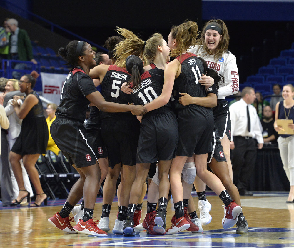 Members of the Stanford women's team celebrate after defeating Notre Dame to win the Lexington regional final of the NCAA women's college basketball tournament, Sunday, March. 26, 2017, in Lexington, Ky. (AP Photo/Timothy D. Easley)
